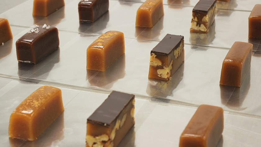 An array of gourmet caramels from Sweet Jules sit lined up in a row