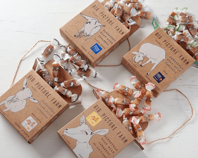 Four boxes of different flavors of Big Picture Farm's goat milk caramels are seen