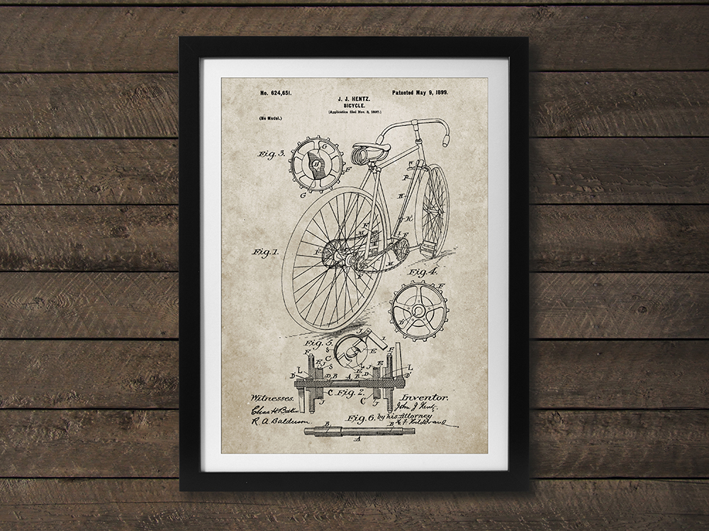 The original patent for the bicycle is seen framed like art on a wall from PatentPrints