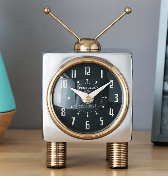 A Pendulux TeeVee table clock sits on a desk