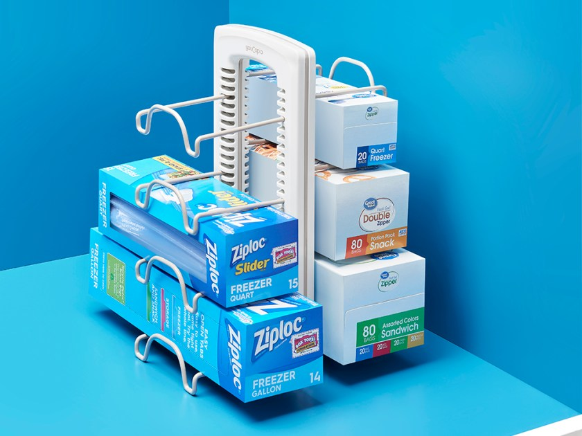 Boxes of Ziplock bags in varying sizes are seen organized in a WrapStand kitchen wrap organizer from YouCopia