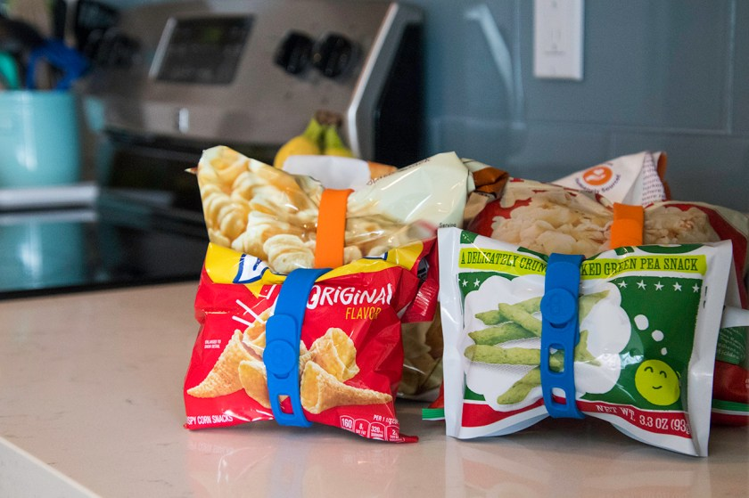Bags of snacks are seen clipped closed using Packbands silicone organization bands