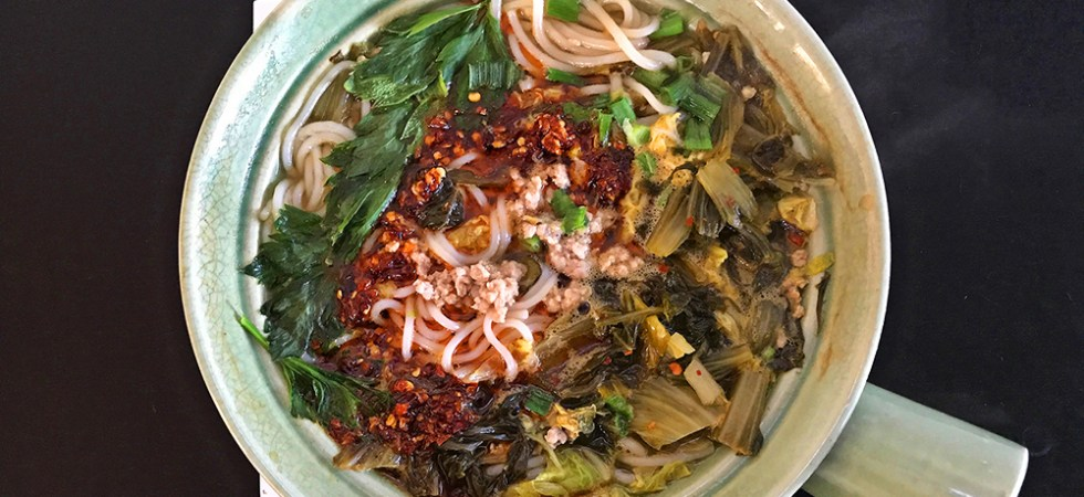 yunnan mixian rice noodle soup with pork and spicy pickled greens