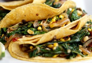 Onions, mushrooms, and sweet corn liven up these delicious vegetarian tacos.