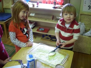 A younger student gets some pointed help from his older classmate.