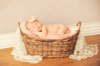 baby in a basket peach and netrals