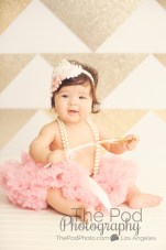 baby in a bucket, pearls gold and white, pink tutu