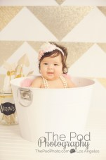 gold and white baby photo shoot