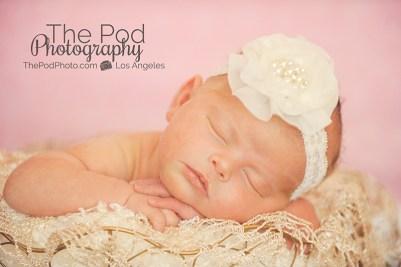 sleeping-newborn-baby-pink-and-white