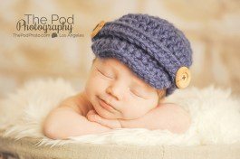 smiling-baby-in-blue-hat-photography
