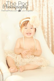 One-Year-Old-Portrait-Photographer-Marina-Del-Rey-Studio-Pod-Glow-Classic-Chair-Tutu-Lace-Headband-Pearls-Sparkle-Sequins