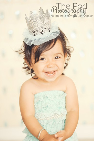 Best-First-Birthday-Cake-Smash-Photographer-Los-Angeles-Portrait-Studio-Sparkle-Sequins-Silver-Crown-Tutu-Romper-Teal-Cute-Baby-Girl