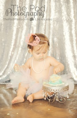 Best-First-Birthday-Cake-Smash-Photographer-Los-Angeles-SusieCakes-Teal-White-Silver-Pink-Looking-At-Cake