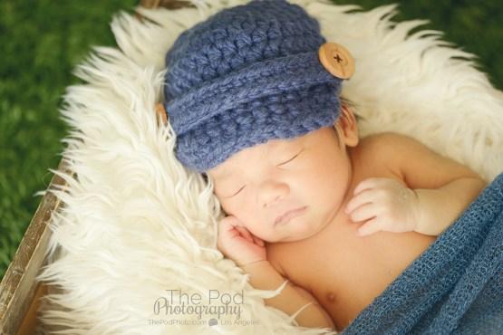 soft-cuddly-baby-pics-newborn-in-a-wood-crate