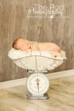 infant-on-silver-scale-boy-silver