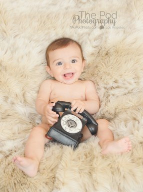 naked-baby-with-a-phone-portrait