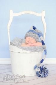 smiling-newborn-in-amilk-bucket