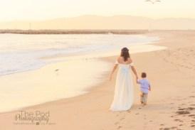 mother-and-son-walking-at-the-beach-at-sunset-playa-vista