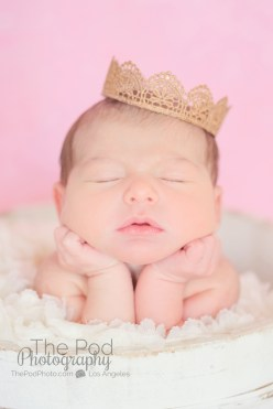 infant-girl-wearing-a-gold-crown