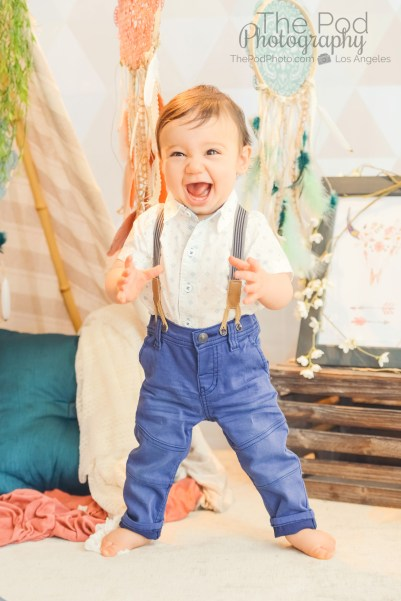 12-month-milestones-baby-standing-up-alone-cute-boho-photography-set