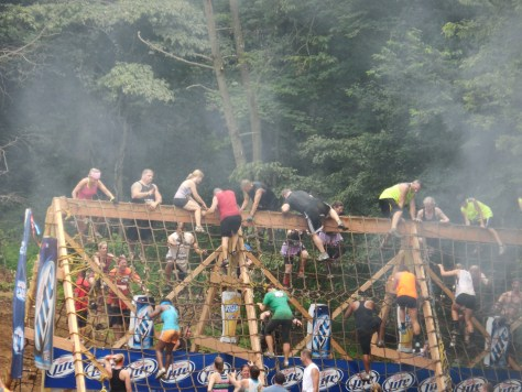 There I am right in the middle climbing over dressed in black with white striped shorts.