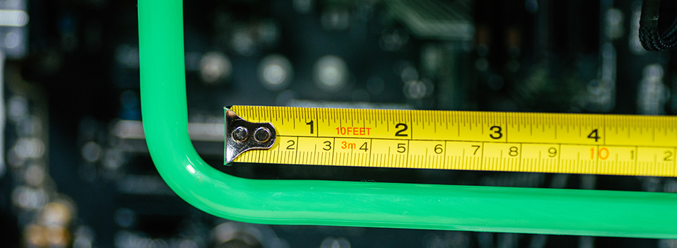 A close-up of a PETG tube with a measuring tabe against it.