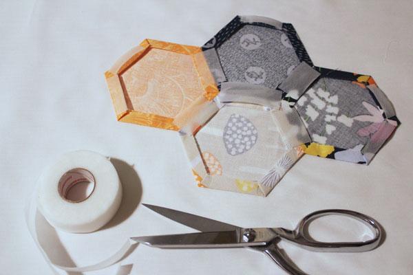 place segments of hem tape on seams
