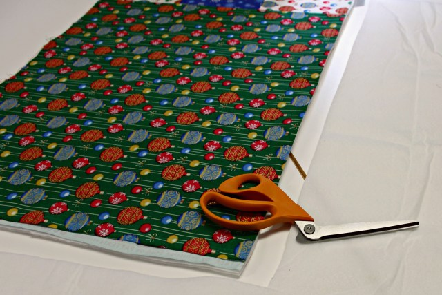 cutting fusible fleece for Christmas table runner by Carla at Creatin in the sticks for Thermoweb