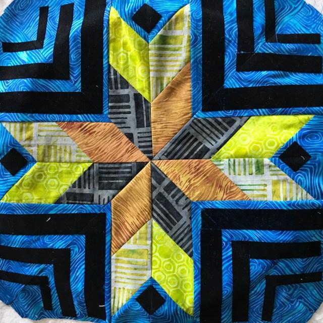 mini island batik quilt with flock