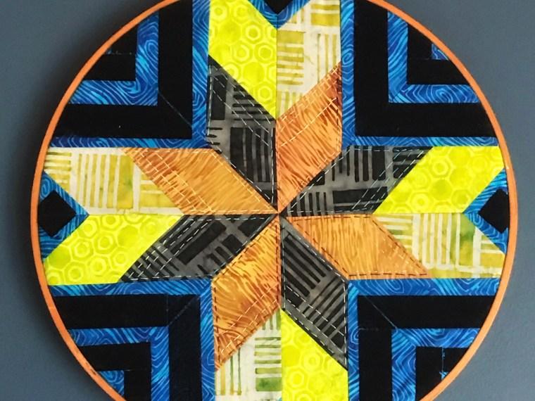 Island batik Star featuring Decofoil Flock