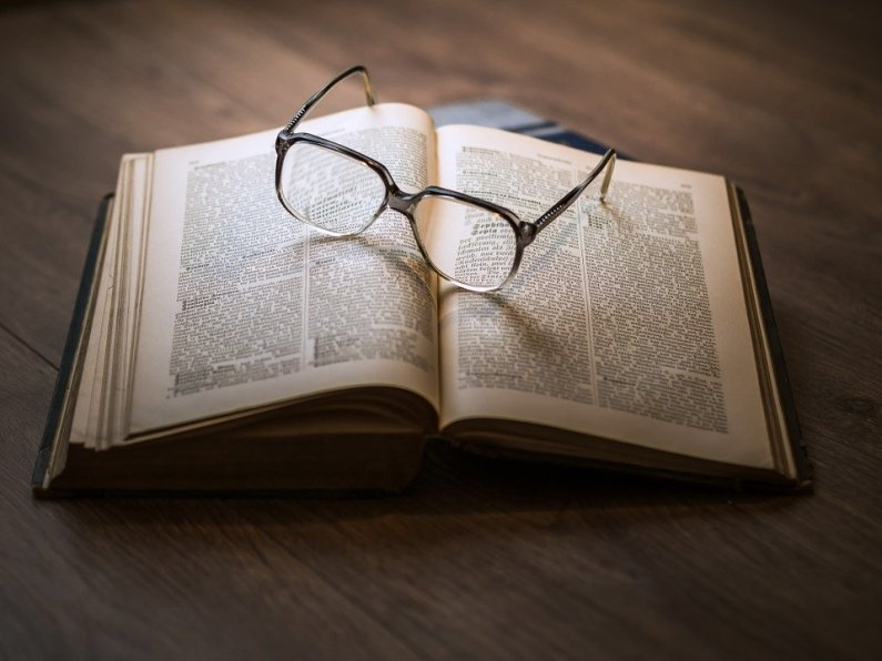 Glasses resting on an open book