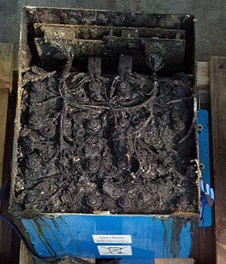 The failed battery from the ANA flight on Wednesday, showing the eight charred cells inside it.