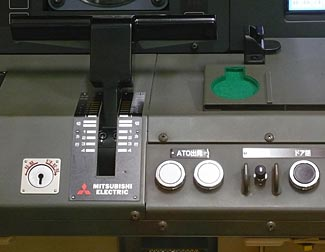 In this Japanese semi-automatic train control system, all the 'driver' now does is push the two white buttons to start the train.