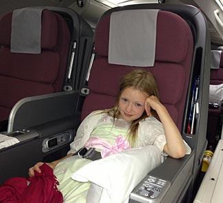 My daughter Anna struggling to stay awake on the Qantas night flight to Sydney.