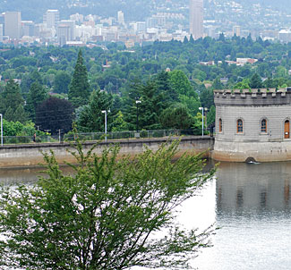 One of the Mt Tabor reservoirs in Portland, with the downtown area nearby in the background.