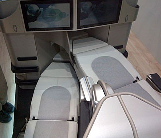 A new approach to business class seat design and space saving with one person's legs above/below the other's.  See article below.