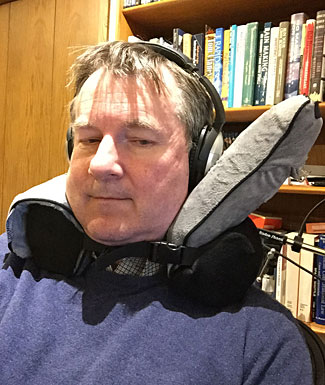 Maybe this travel pillow is good for facilitating a deskchair snooze, too!  Your intrepid reviewer struggling to stay awake.