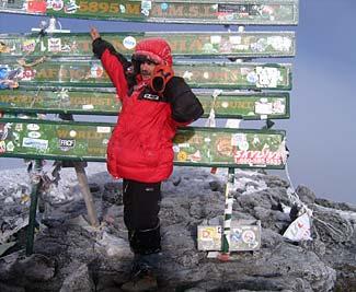 My friend Sasha on the summit of Kilimanjaro.