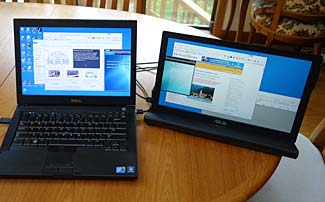 My new Asus external USB monitor alongside an older Dell laptop.