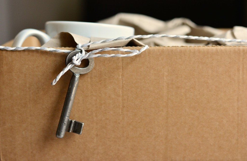 A box filled with clutter, part of a decluttering New Year's resolutions.