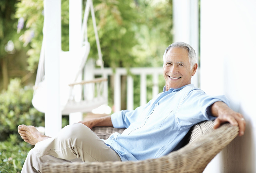 a man in a chair on his porch