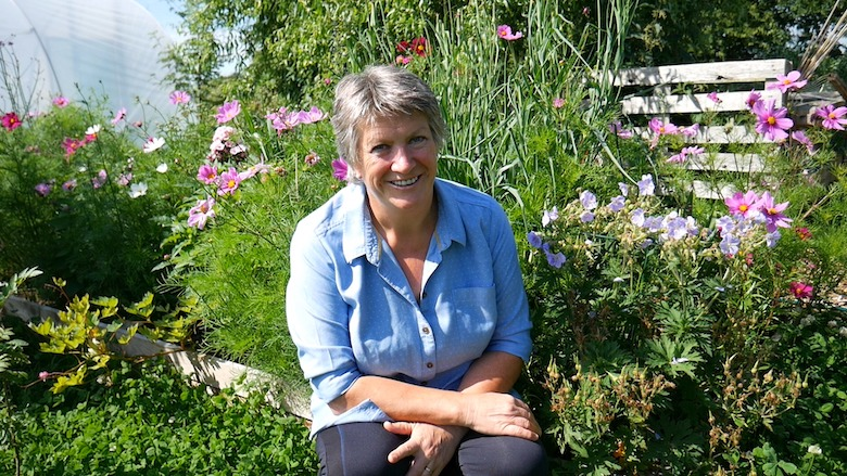 Liz from Byther Farm sitting in her garden