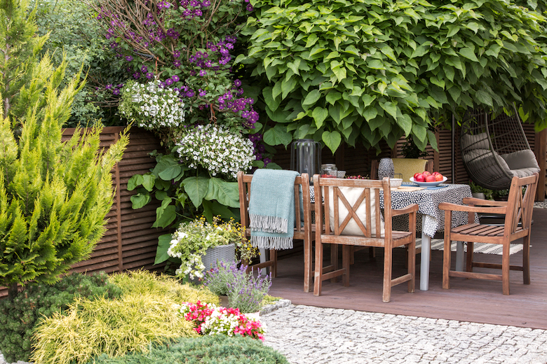 Stock image of an outdoor dining area with table and colourful borders