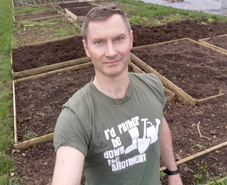 Dave from greedy gardens standing in his allotment