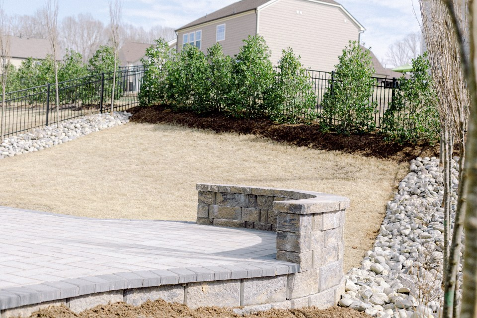 The completed backyard designed by Fawn Renae Designs and installed by Those Plant Ladies in Charlotte, NC.