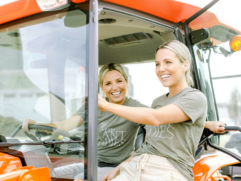 Fawn and Heather of Those Plant Ladies on the sponsored tractor from Kubota in Charlotte, NC.