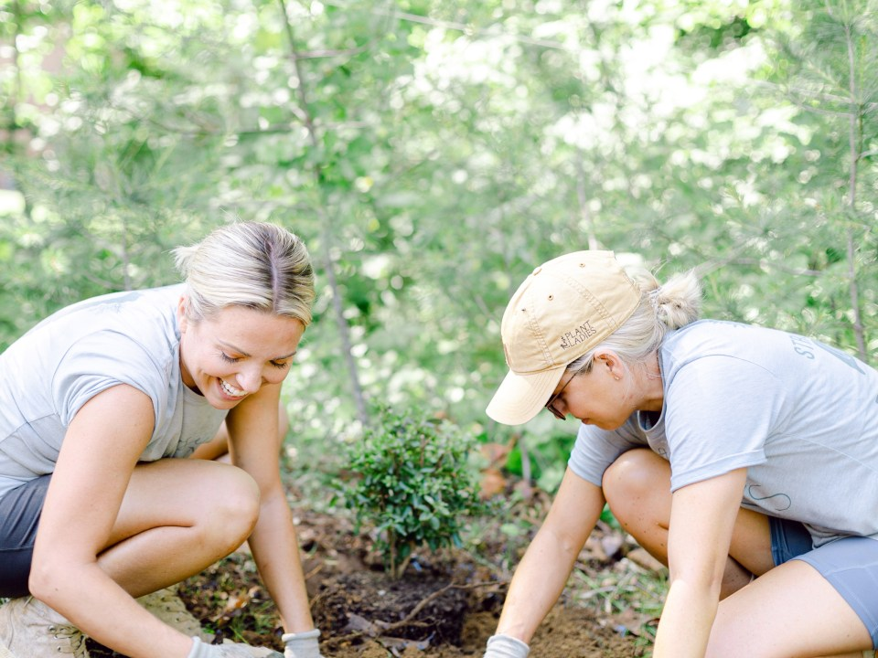 Fawn and Heather of Those Plant Ladies installing plants at a landscape installation.