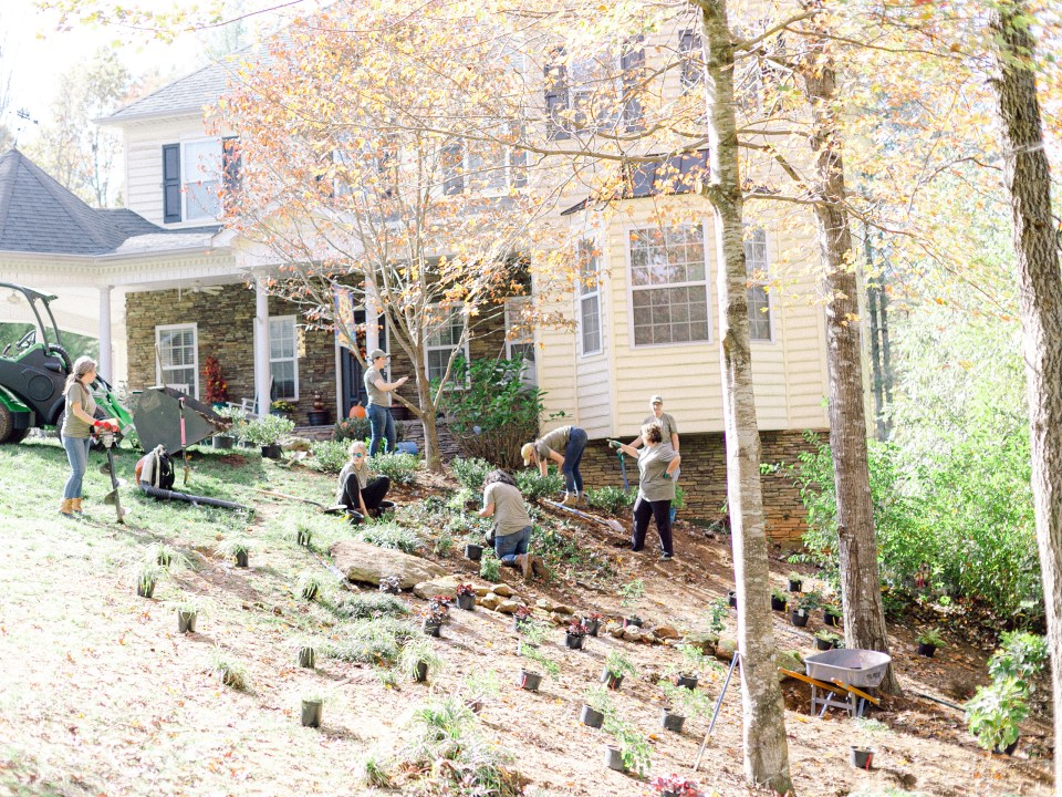 The crew of Those Plant Ladies at the English Perennial Garden Installation  as they mulch and plant on hillside.