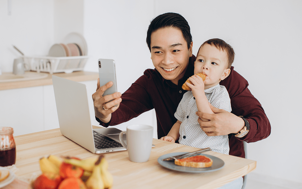 Operations Manager working from home with his son while having breakfast together