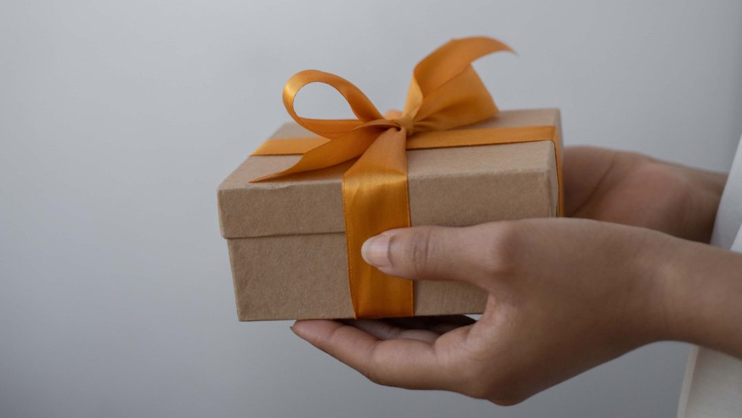 Person holding the gift box in their hands